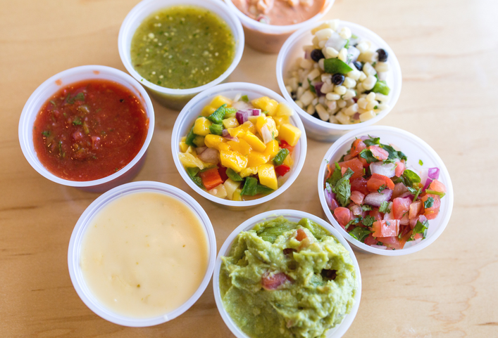 Salsarita's Fresh Mexican Grill - Salsa with toppings, guacamole, and queso.